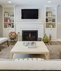 living room bookcase built ins and painted brick fireplace the built ins and the