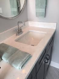 bathroom with quartz zodiaq co carrara countertops