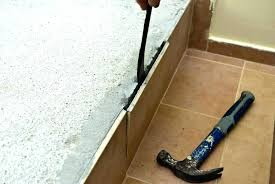 remove ceramic tile floor from concrete removing wall without breaking it bathroom damagi