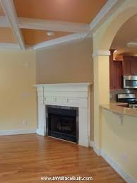 madison custom built fireplace with brown accent wall