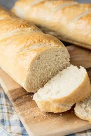french bread loaf. Modren Loaf Loaf Of Homemade French Bread Sitting On A Cutting Board With Couple  Slices Next In French Bread E