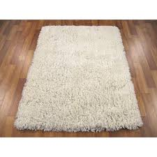 rug white. enhance looks and comfort of your place by using white shag rug