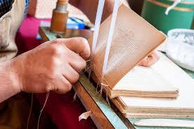 bookbinding male worker binding pages stock photo image of equipment photography