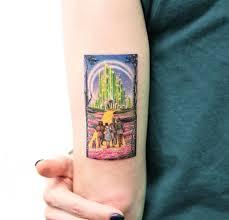 The Wizard Of Oz Miniature Tattoo On Girls Upper Arm Best Tattoo