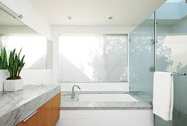 bathroom: Glossy Glass Material In Minimalist Bathroom With Small Low  Bathub Close Wooden Vanity Plus