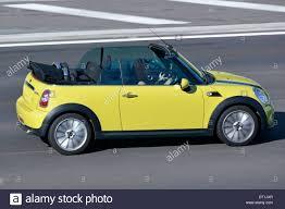 Coupe Series bmw two door : Two door BMW Mini Cooper open top convertible car with woman ...