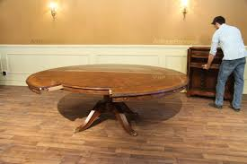 some folks call this style dining table a perimeter table because the leaves go around the outside