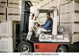 Stock Photo Of Mature Man Driving Forklift Truck In Warehouse
