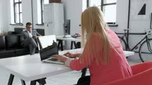 wide angle view busy design office. Young Business Woman Working At Shared Desk In Trendy Hipster Start Up Office Using Big Data Wide Angle View Busy Design A