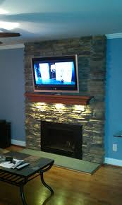 led puck lights under your fireplace mantel diy fireplace mantel home decor stone