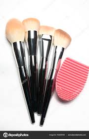 set of used makeup brushes with metal handles and rubber brush c stock photo