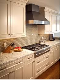 Bianco Romano Granite Kitchen Here Is An Example Of White Kitchen With Grey Glass Subway Tile