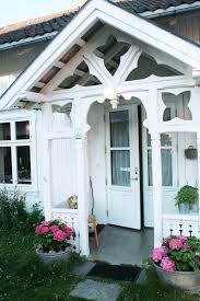 norway front porch entry with bronze outdoor wall lights and sconces entry victorian potted plants turf