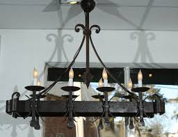 black painted wrought iron rectangular chandelier with 8 lights