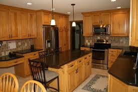 dark counters with wood cabinets kitchen countertop backsplash