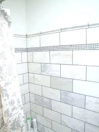 large subway tile walk in shower with dark grout white beveled marble bathroom format