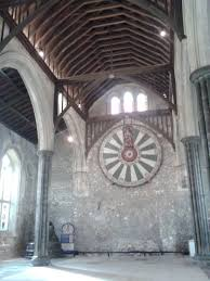 the round table hangs inside winchester castle s great hall photo courtesy almudena alonso herrero