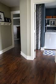 earth tone colors on various walls with dark wood floors