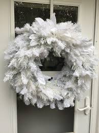 flocked white artificial holiday wreath 1