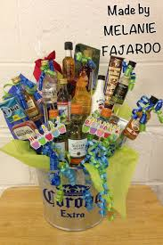 liquor gift basket attach mini bottles to wooden skewers by using clear packaging tape use fl foam in bottom of bucket