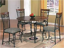 retro round wood and metal dining table with cushioned chairs
