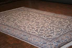 323 nain rugs this traditional rug is approx imately 6 feet 8 inch x 10