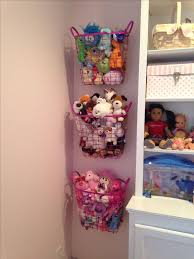 Organizing Stuffed Animals - spray painted metal baskets