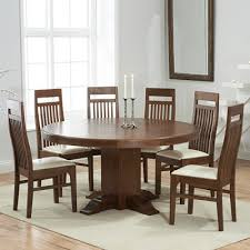trina dark solid oak round dining table with 6 monty chairs