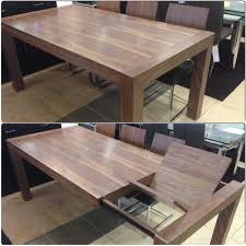 walnut extendable dining table with erfly leave on display at furniture toronto showroom 700