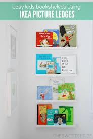 make kids bookshelves using ikea ribba picture ledges via the sweetest digs