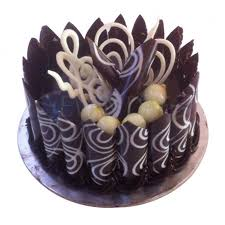Chocolate Cake Covered With Cones Topped With Chocolate Garnishing