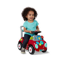 busy buggy this new interactive ride on encourages imaginative play and helps develop both fine and gross motor skills it is also a child push walker