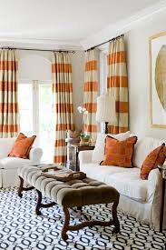 love the orange curtains--Orange and white horizontal striped curtains