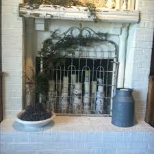 painted fireplace with old gate screen beautiful