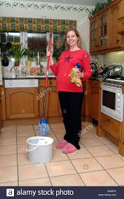 Kitchen Floor Mop Mum To Be Pregnant Woman Cleaning Floor With Mop And Bucket Stock