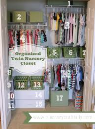 An organized twin nursery closet - using fabric-covered diaper boxes and  dollar store bins