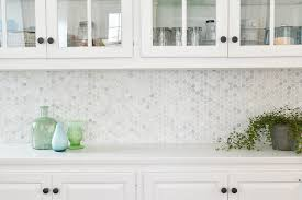 i love the subtle texture this marble tile brings to our kitchen the variations of tone are lovely against our white counter and white cabinets