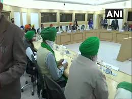 Union Ministers Narendra Singh Tomar, Piyush Goyal attend meeting with  farmers' leaders at Vigyan Bhawan