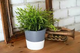 Paint it to look like a concrete planter