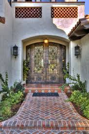 arched front doorEclectic Front Door with exterior brick floors by Jay Andre