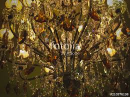 old crystal chandelier close up light effect texture of glass