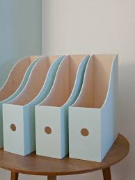 Units of white magazine and paper holders by IKEA