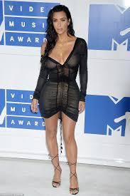 Kim Kardashian sizzles in sheer mini as she leaves VMAs with.