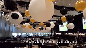 giant cloudubster ceiling installation balloons decor video tour
