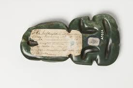 label on reverse of hei tiki pounamu nephrite jade
