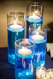 floating candles, blue dyed water, tea lights