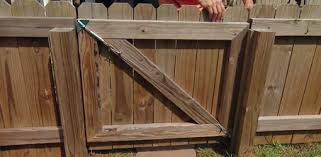 fence gate. antisag gate kit installed on wooden fence to prevent sagging e