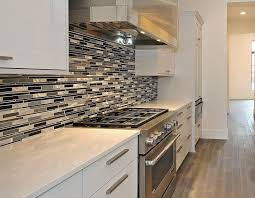 kitchen remodel project with quartz counter and glass backsplash