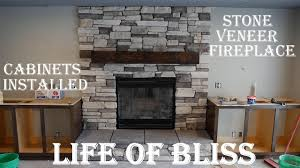 installed stacked stone fireplace stained built in cabinets basement build 18