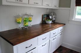 butcher block countertop on white kitchen base cabinet